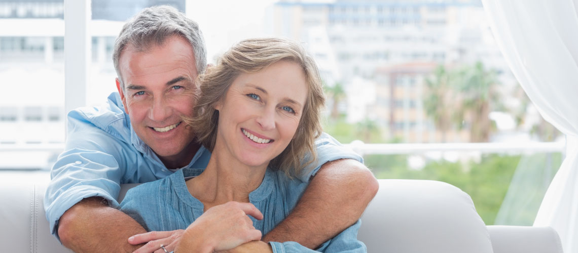 older couple with dental implants smiling