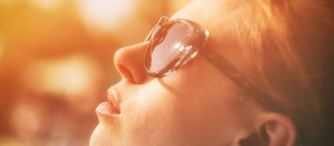 girl wearing sunglasses looking up