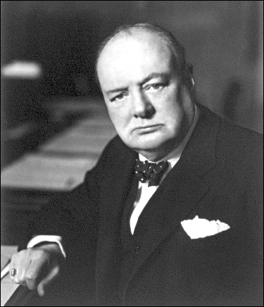 Winston Churchill wears a dark suit, bow tie, and dentures as the British Prime Minister during World War II