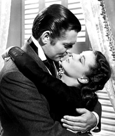 Clark Gable embraces Scarlett O'Hara and wears dentures as he plays Rhett Butler in Gone with the Wind